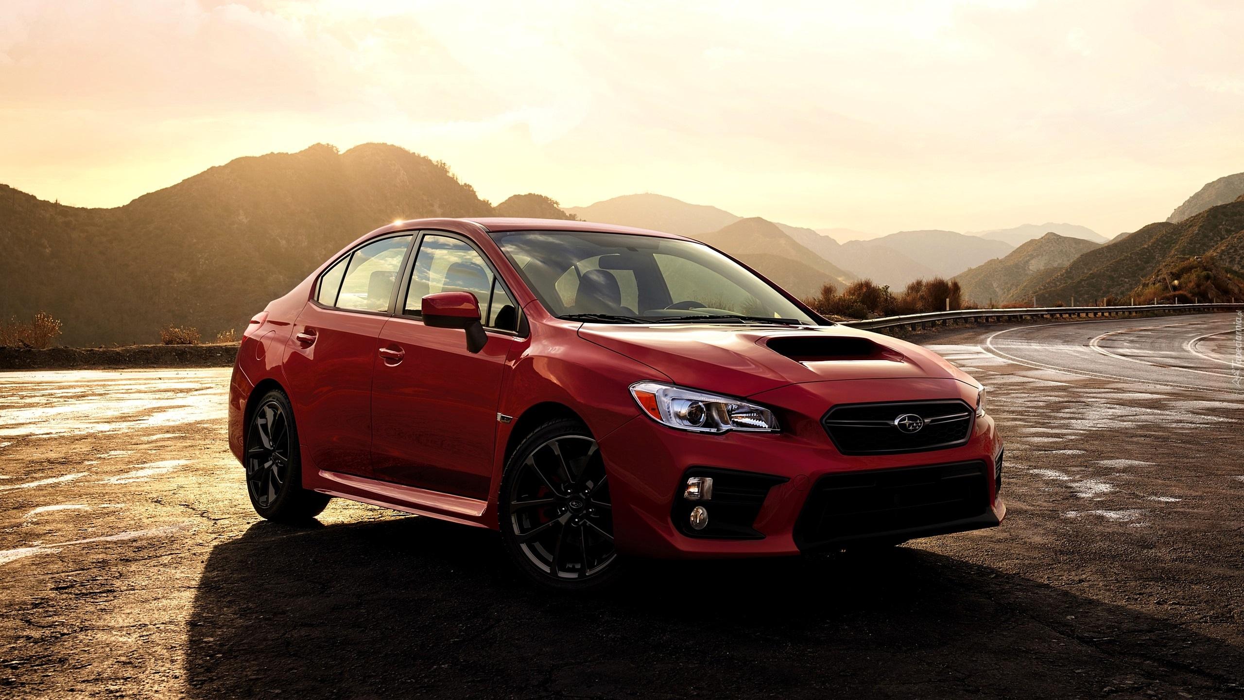 Wrx Cvt >> Czerwony samochód Subaru WRX STI na drodze w górach