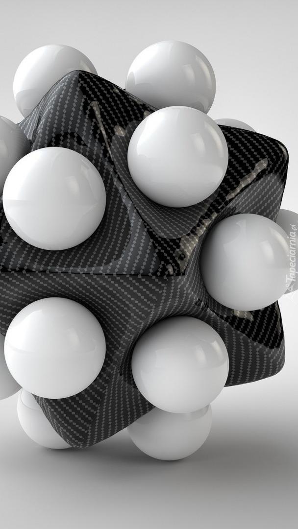 Białe kule w szarej bryle