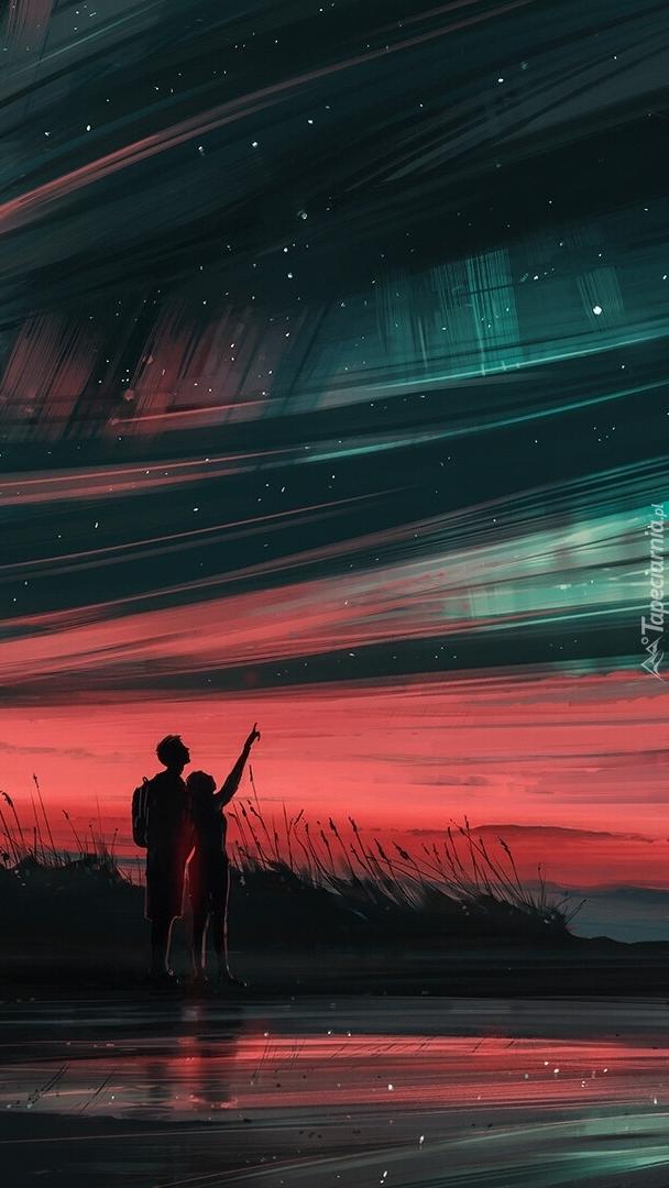 Chłopak z dziewczyną oglądający gwiazdy