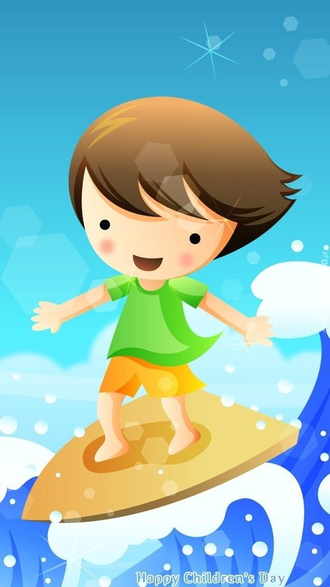 Chłopczyk na desce surfingowej