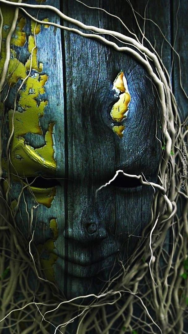 Drewniana maska w grafice fantasy