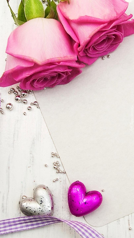 Dwa serca i dwie róże na kartce