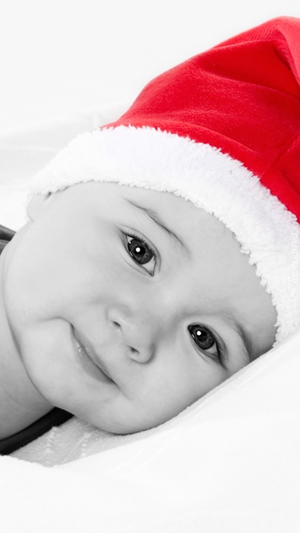 Dziecko w czapce Mikołaja