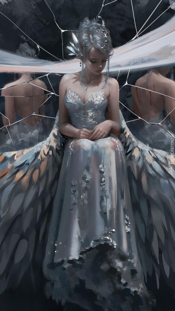 Dziewczyna elf przy popękanym lustrze