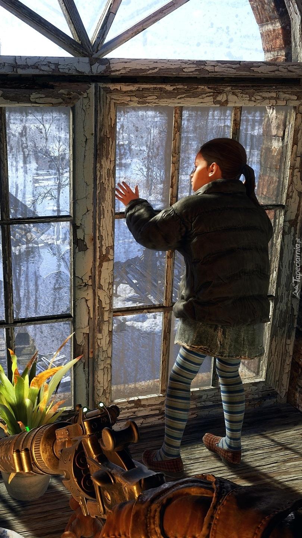 Dziewczynka patrząca przez okno