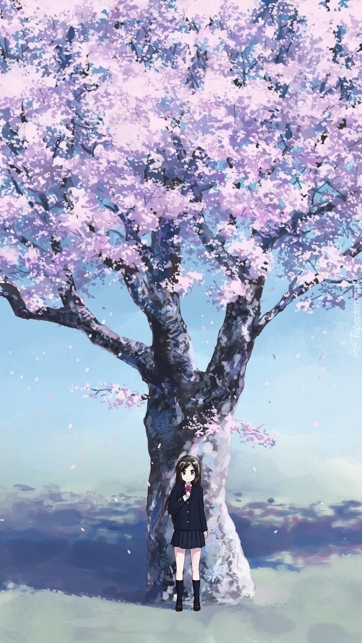 Dziewczynka pod kwitnącą wiśnią