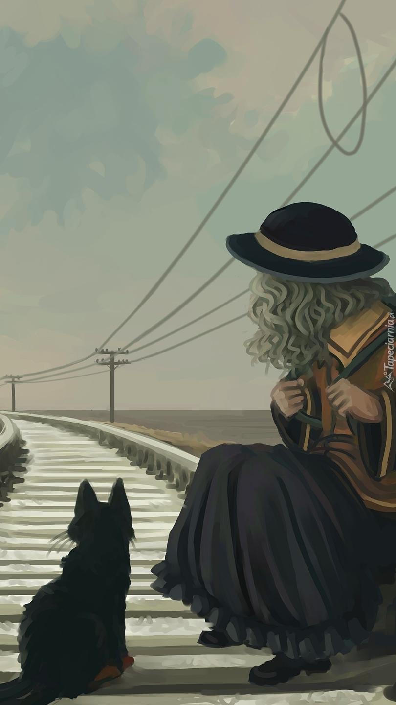 Dziewczynka z kotem na torach