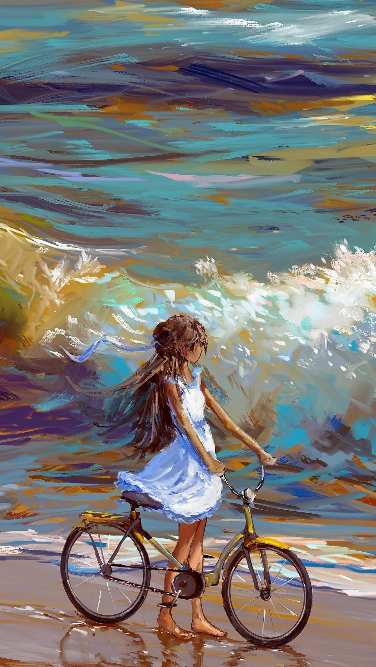 Dziewczynka z rowerem na brzegu morza