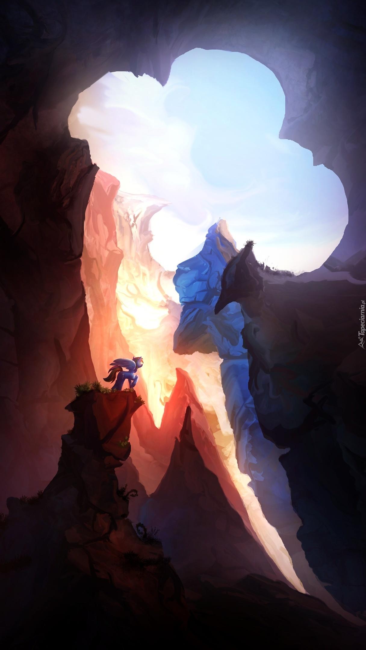 Głęboka jaskinia a nad nią piękne niebo