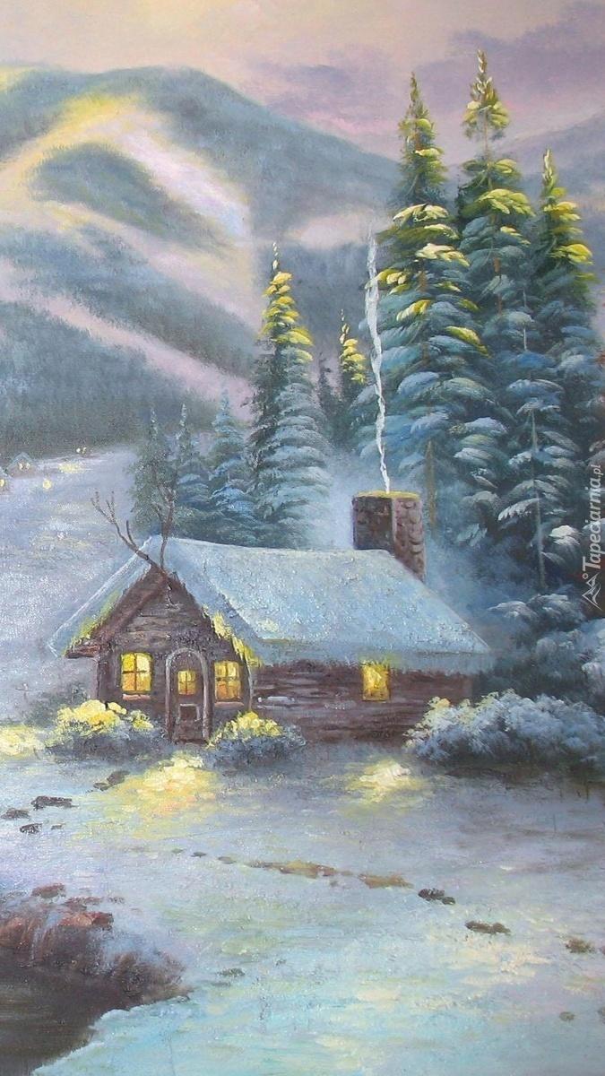 Góry i domek w zimowej scenerii