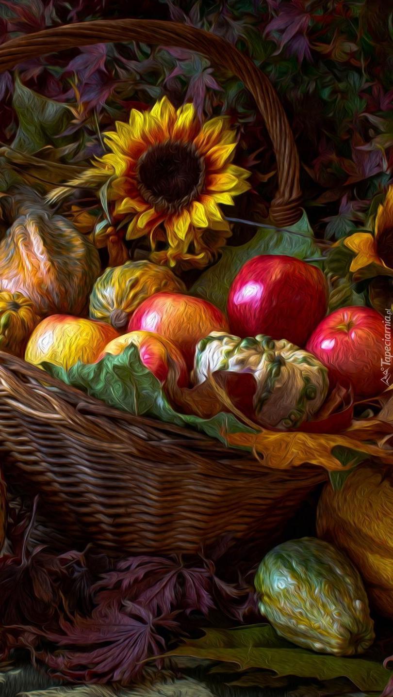 Jabłka i dynie w koszyku