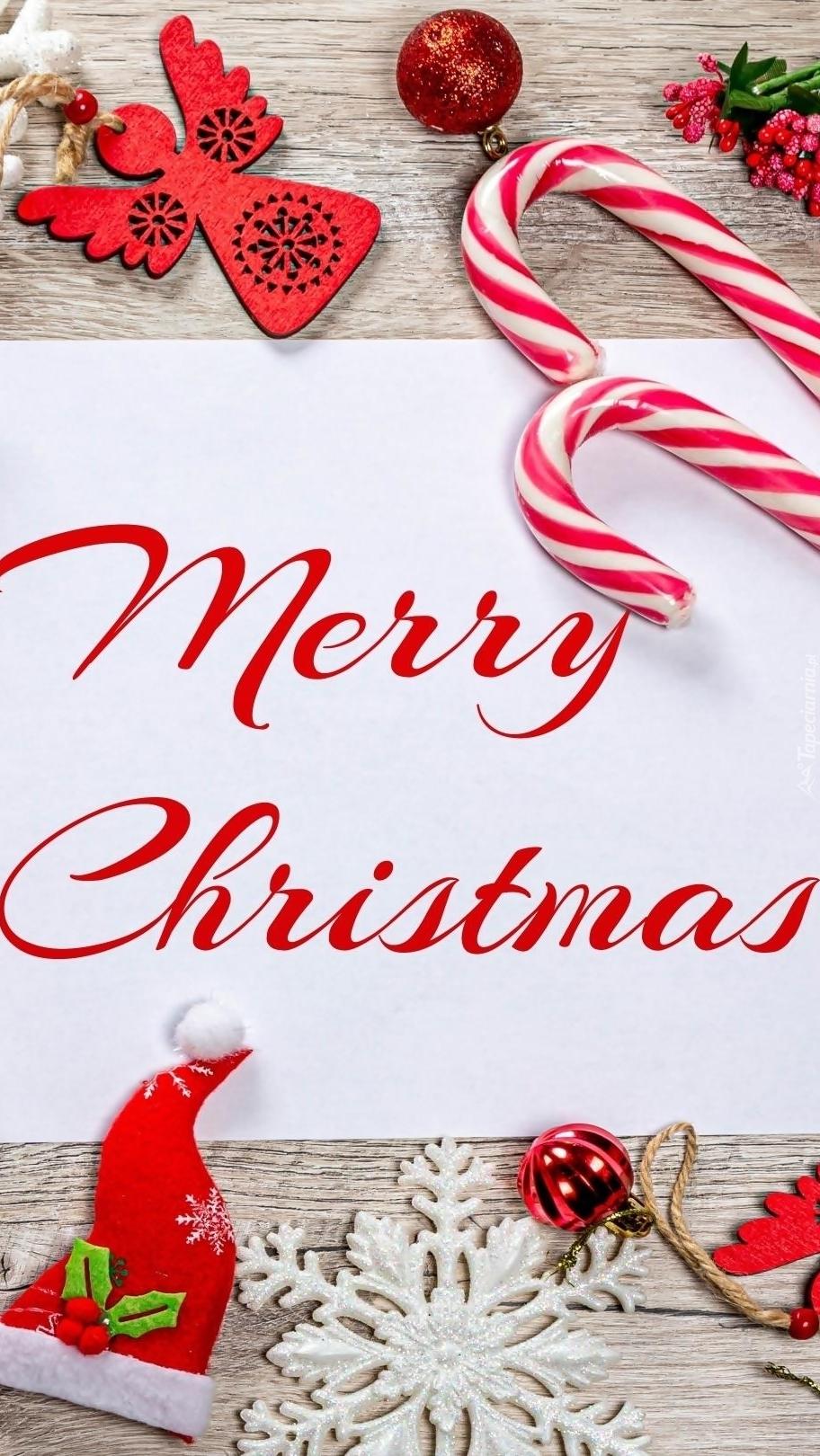 Kartka z życzeniami świątecznymi wśród ozdób