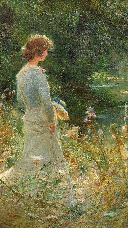 Kobieta na łące nad rzeką