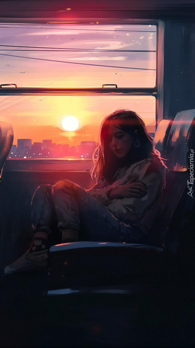 Kobieta przy oknie w pociągu