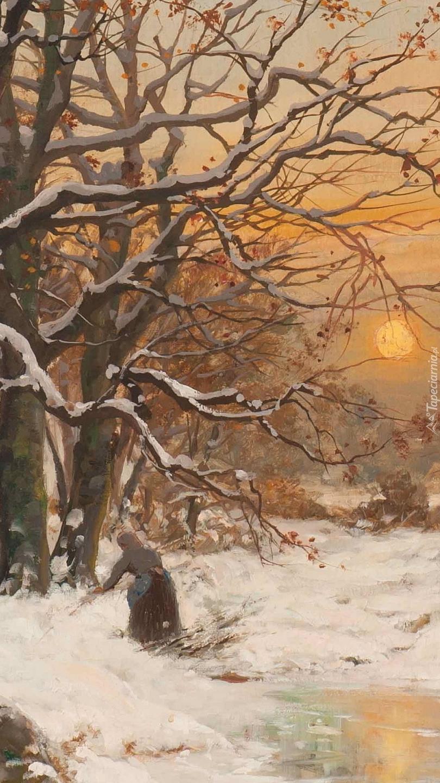 Kobieta w zimowym lesie