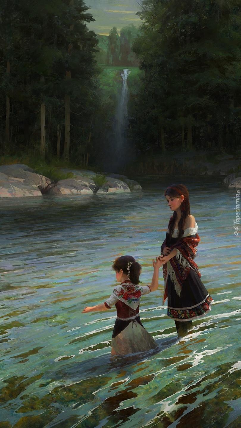 Kobieta z dzieckiem w rzece