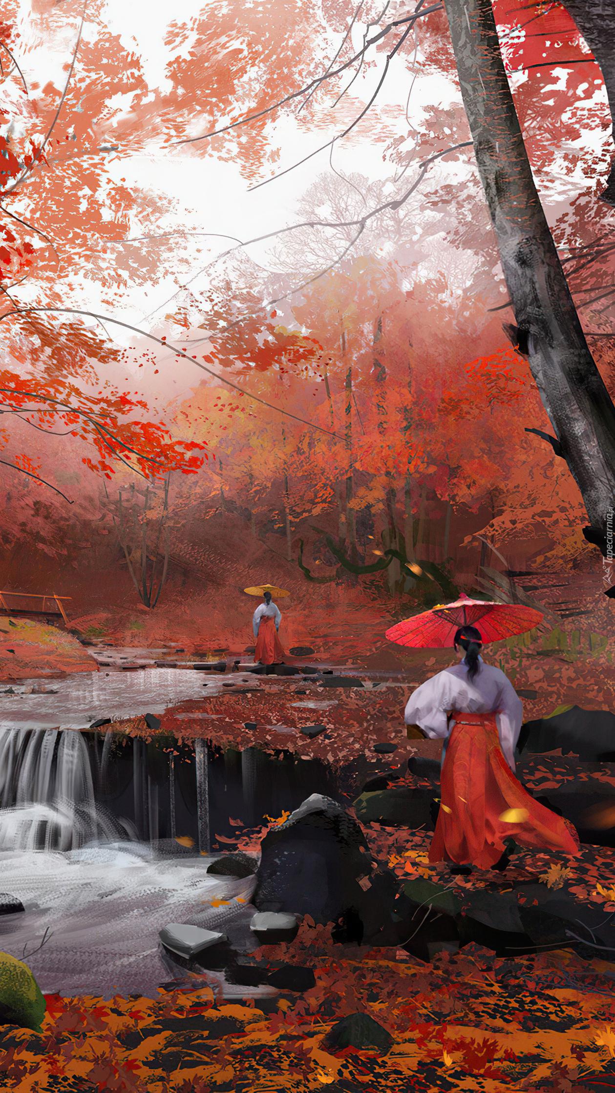 Kobiety nad rzeką w jesiennym lesie