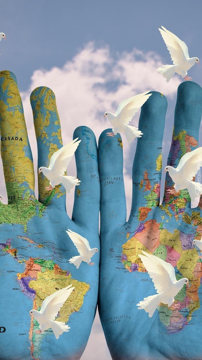 Kontynenty namalowane na dłoniach
