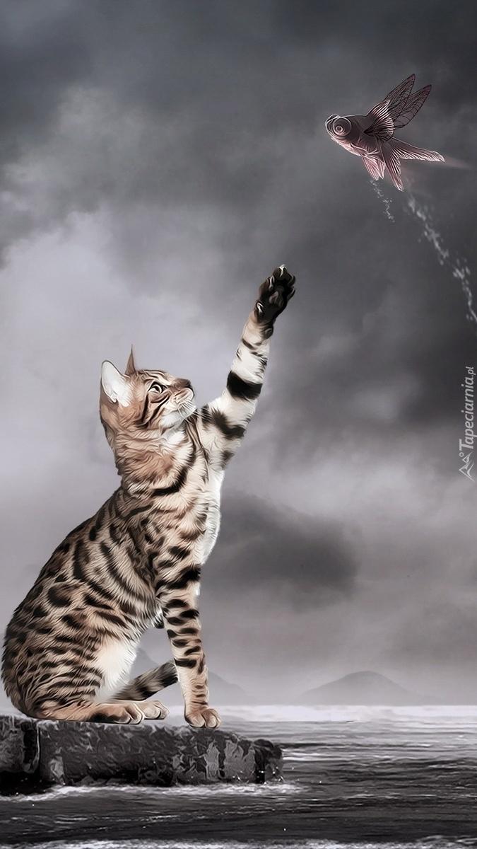 Kot łapiący rybę w locie