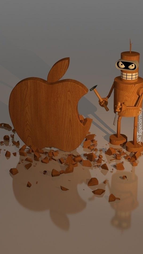 Ludzik z młotkiem przy drewnianym jabłku