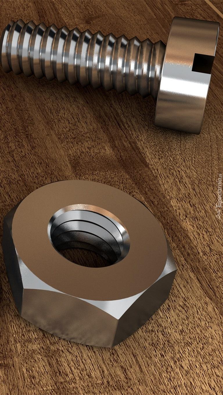 Metalowa nakrętka obok śruby