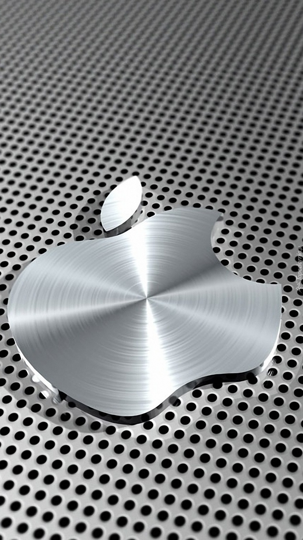 Metalowe Apple na dziurkowanym tle