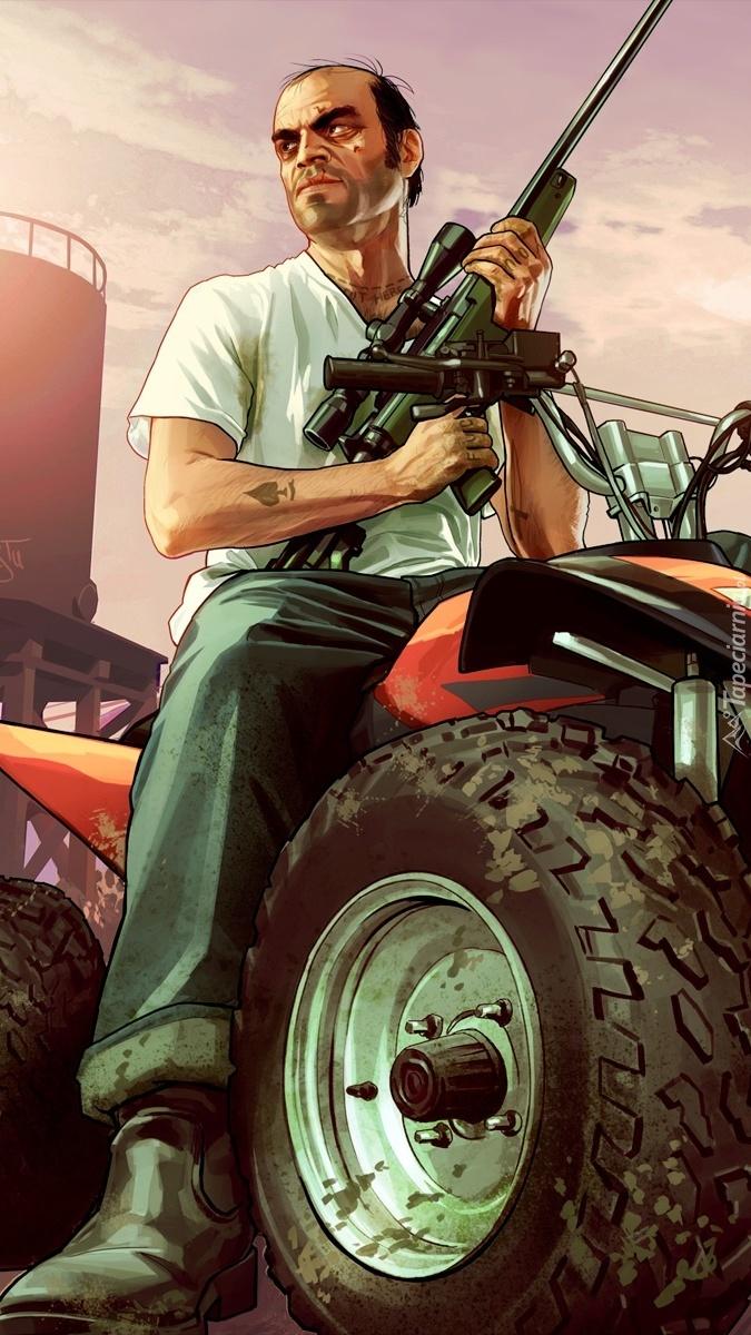 Mężczyzna z bronią na quadzie