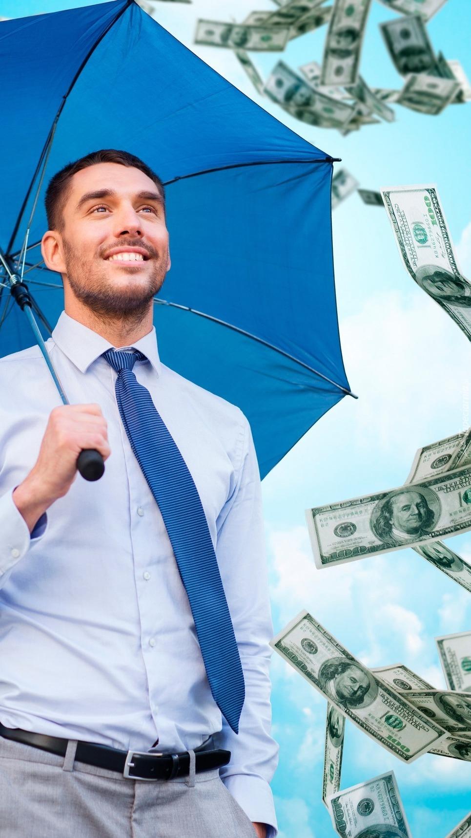 Mężczyzna z parasolem i pieniądze