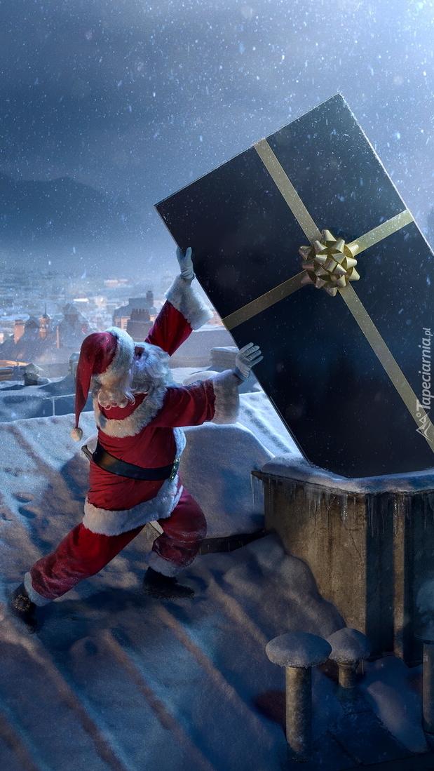 Mikołaj z prezentem na dachu