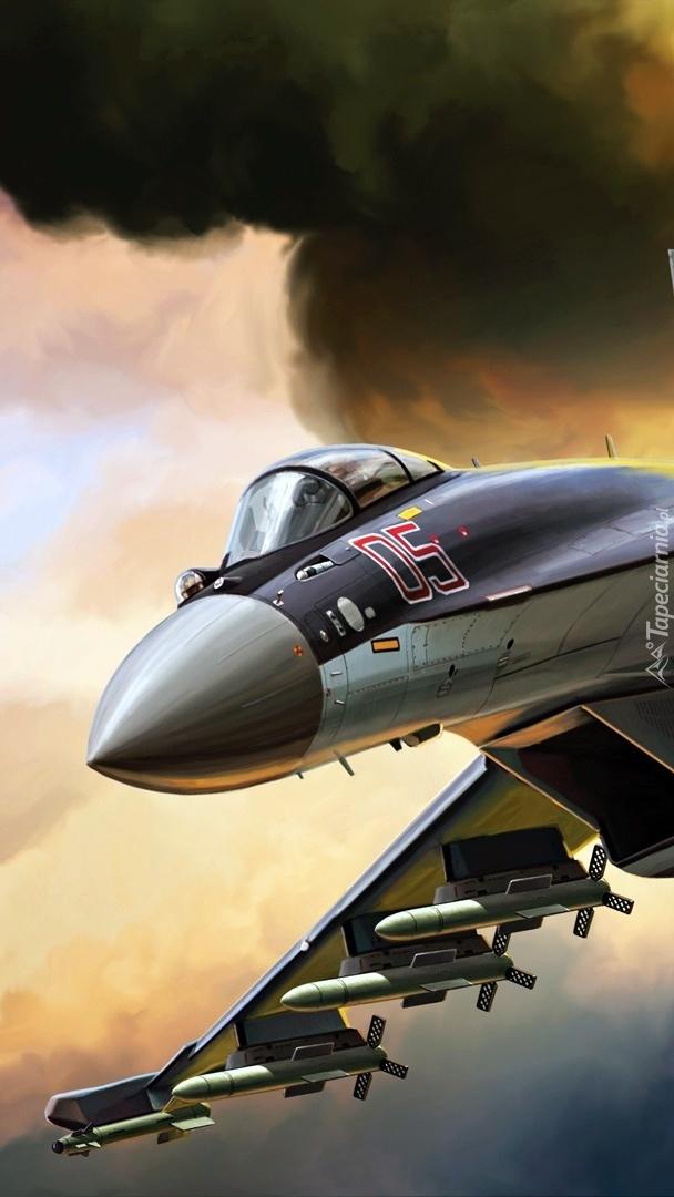 Myśliwiec pod ciemnymi chmurami