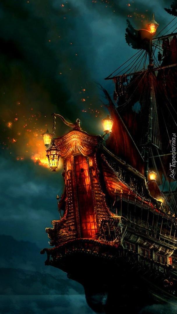 Oświetlony statek na morzu