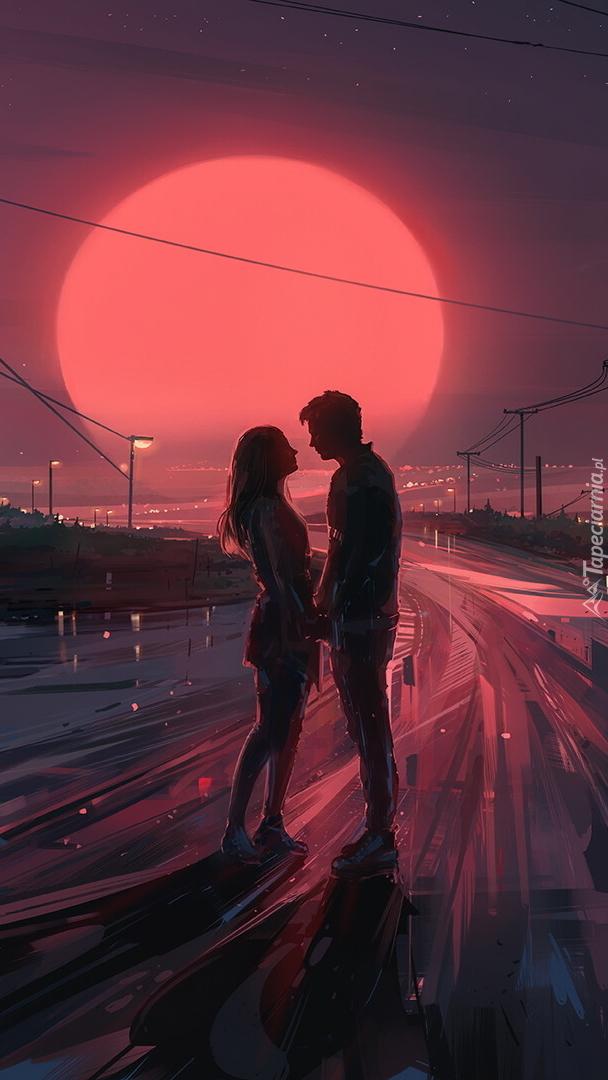 Para zakochanych na tle księżyca