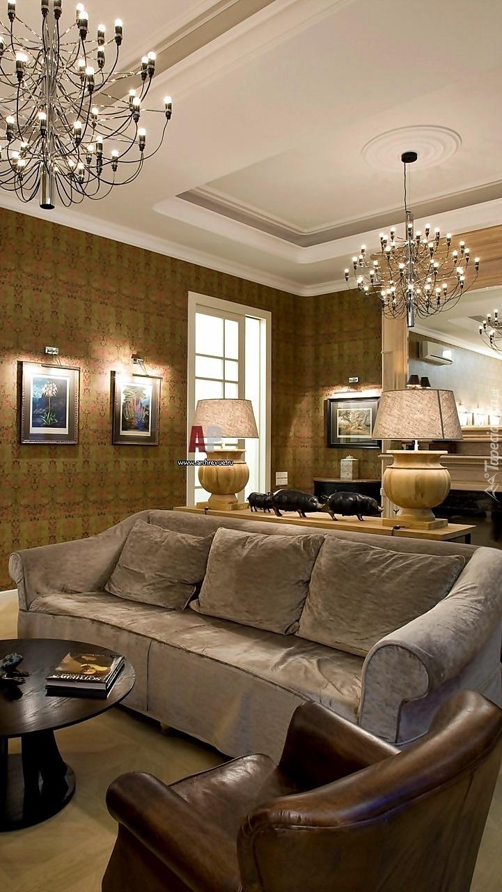 Salon z kanapą i fotelem