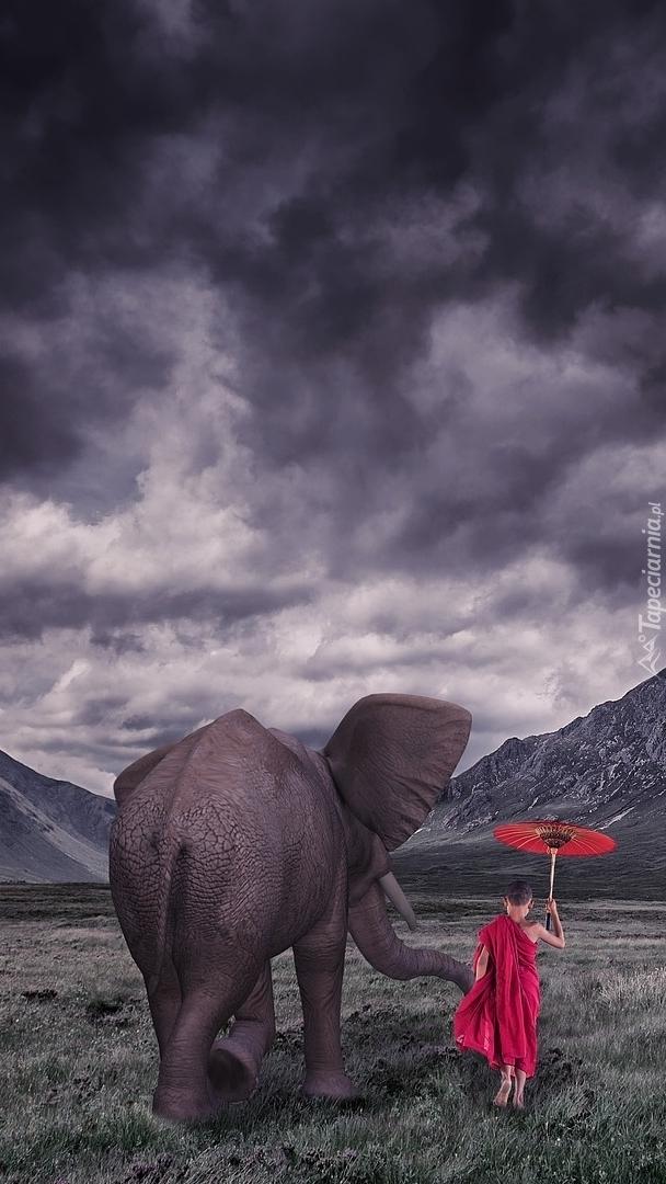 Słoń i dziecko z parasolką