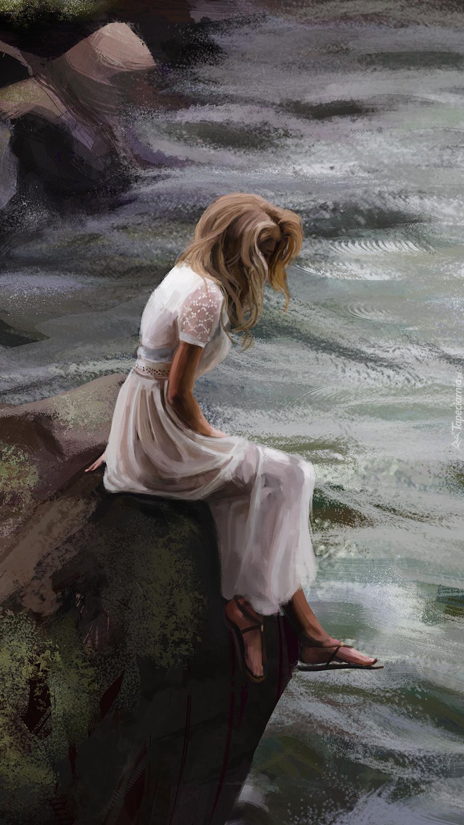 Smutna dziewczyna siedząca na skale
