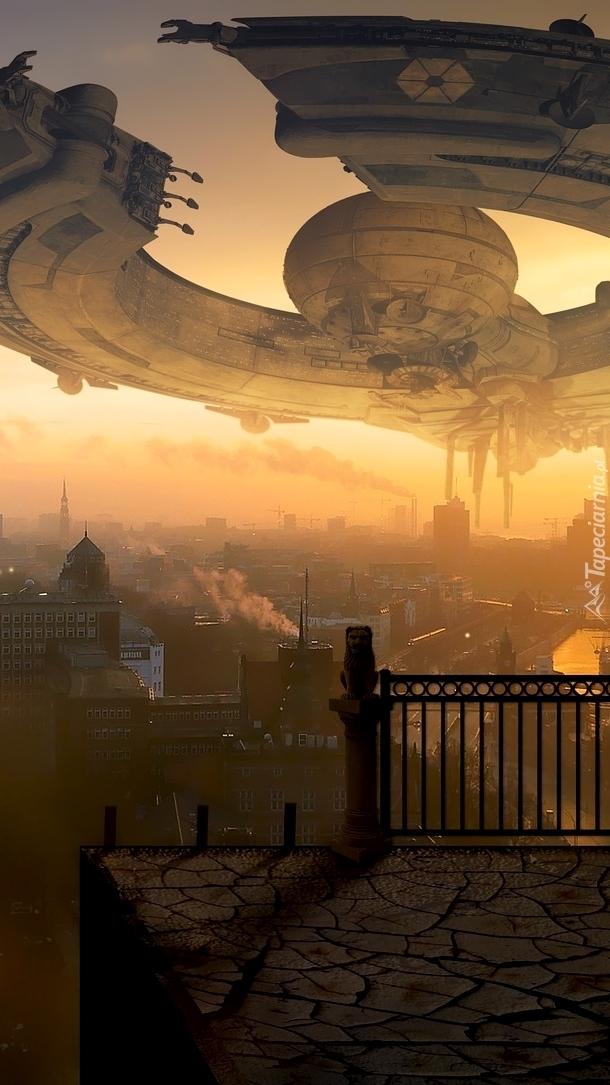 Stataek kosmiczny nad miastem
