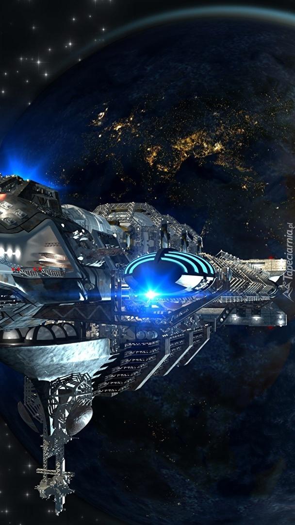 Statek kosmiczny na tle Ziemi