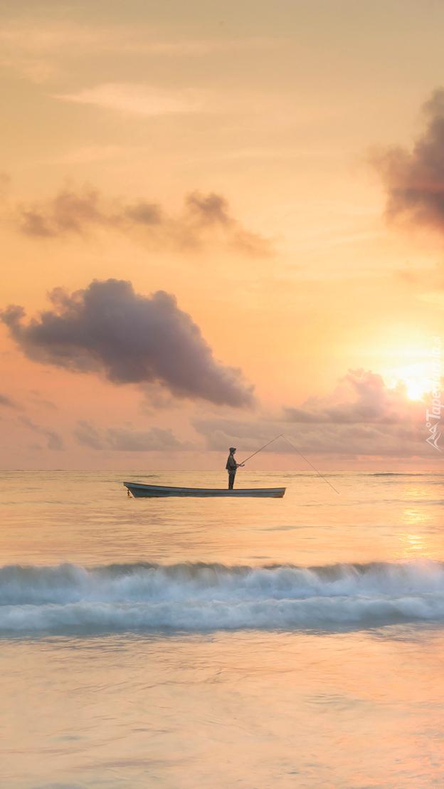 Wędkarz na łódce