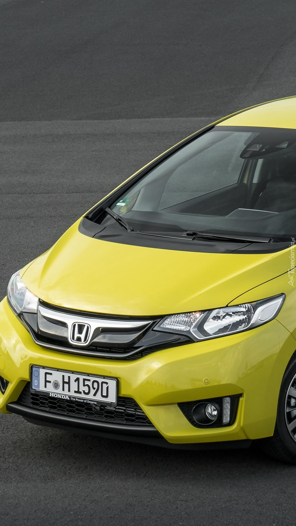 Żółta Honda Jazz
