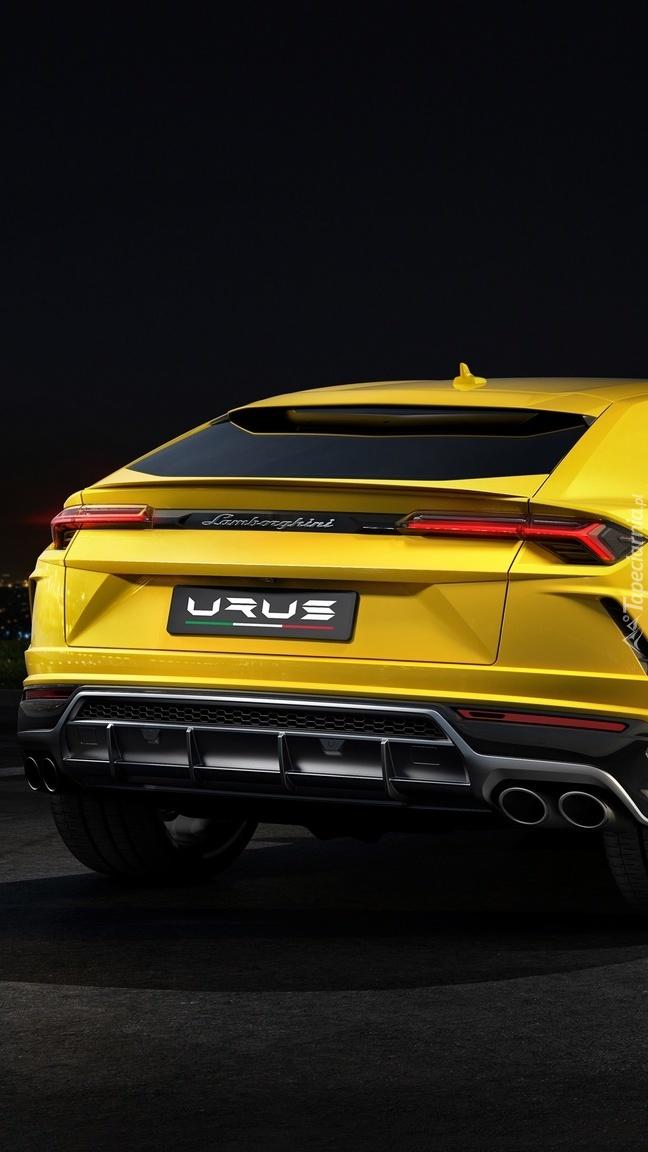 Żółte Lamborghini Urus tyłem